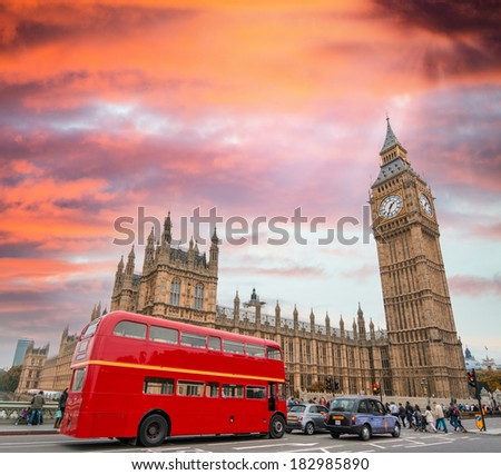 Red Double Decker Bus under Big Ben and Westminster Bridge. - stock photo