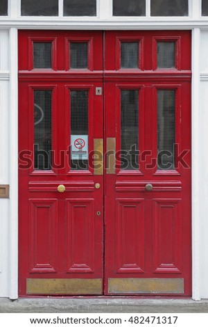 Red Double Door Entrance to Pub