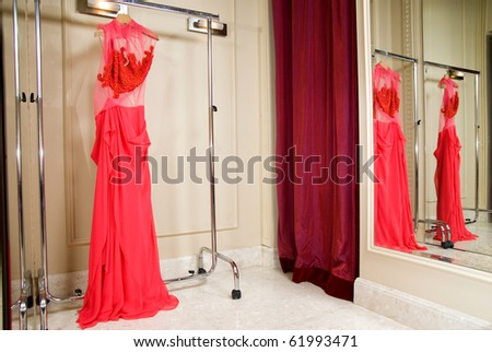 Red dress in the store - stock photo