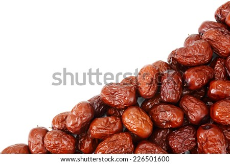 Red dried jujube isolated on white background - stock photo