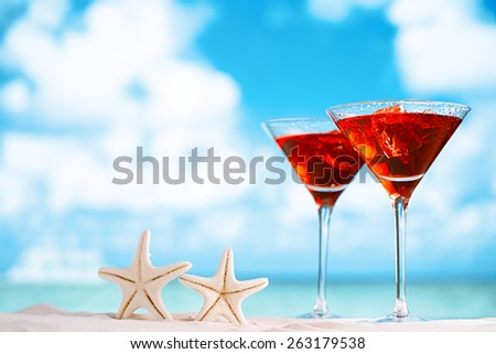 red drink on beach , ocean ,white sand beach and seascape - stock photo