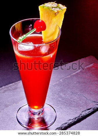 Red  drink  with cherry and pineapple in highball glass . Cocktail card 63 - stock photo