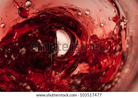 Red drops all over a swirling red whirlpool