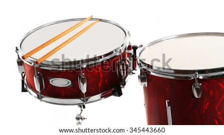 Red drums with drum sticks isolated on white background - stock photo