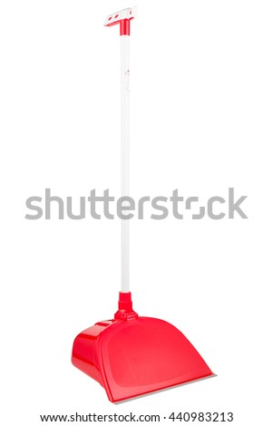 Red dustpan with handle, isolated
