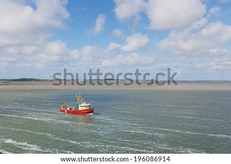 Red Dutch fishing trawler at wadden sea - stock photo