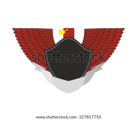 Red Eagle on military emblem. Bird with wings and black shield.    - stock photo