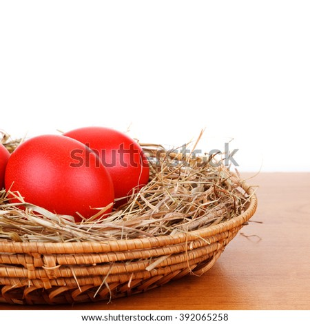 Red Easter eggs in a straw nest