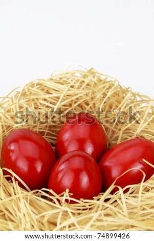 Red easter eggs in the nest