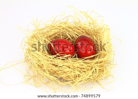 Red eastern eggs in the nest over white background