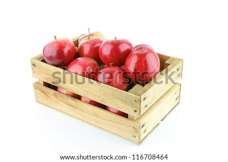 Red Elstar apples in a wooden crate, on a white background.