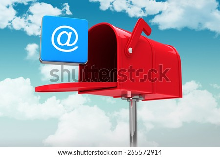 Red email postbox against blue sky - stock photo