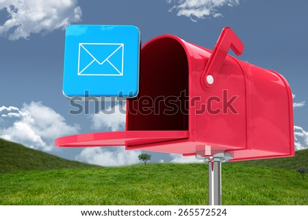 Red email postbox against field and sky - stock photo