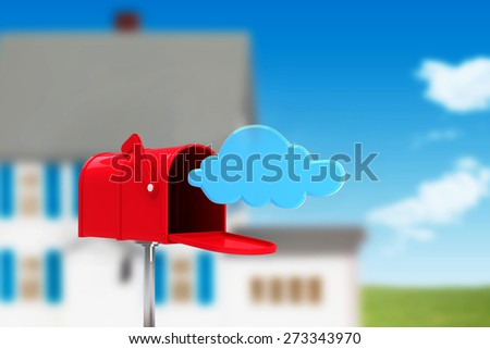 Red email postbox against house in the distance - stock photo