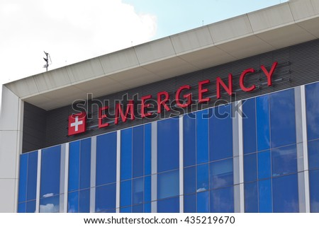 Red Emergency Entrance Sign for a Local Hospital V - stock photo