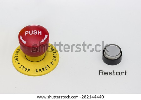Red emergency stop and black reset button on machine for safety. Stop button switch. Selective focus and shallow dof. 