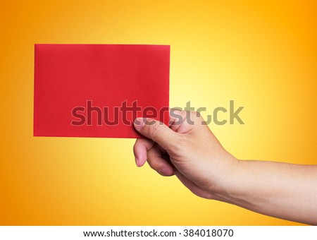 Red envelope in the hand isolated on orange background - stock photo