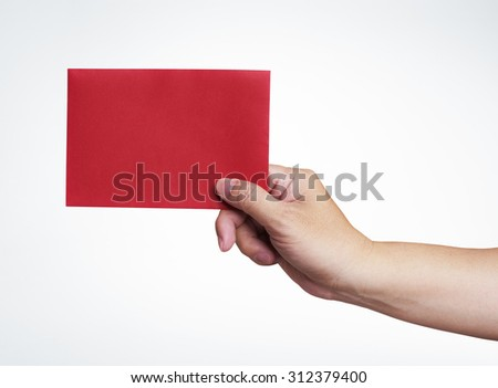 Red envelope in the hand isolated on white background, with clipping path - stock photo