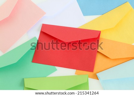 Red envelope on the colorful envelopes - stock photo
