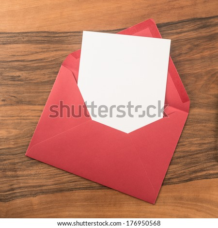 Red envelope on wooden background   - stock photo