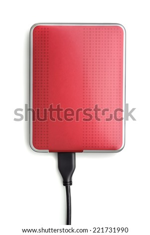 Red external hard disk drive isolated on white - stock photo