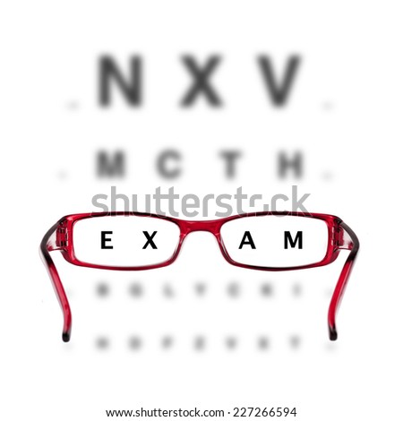 red eyeglasses and eye-chart on white background - stock photo
