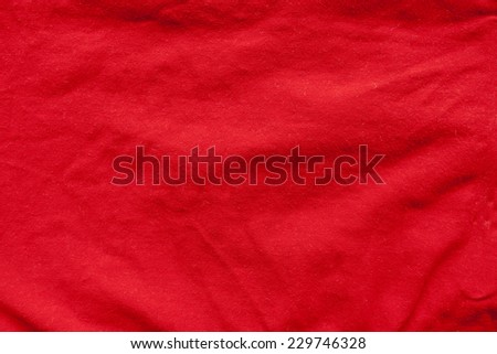 Red fabric background or texture - stock photo