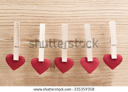 Red fabric heart hanging on the clothesline, Isolated on white background. Love concept - stock photo