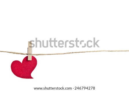 Red fabric heart hanging on the clothesline . On white background - stock photo