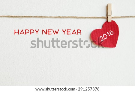 Red fabric heart with happy new year 2016 word hanging on the clothesline, new year template - stock photo