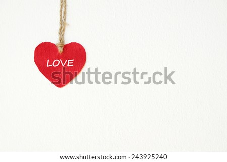 Red fabric heart with love word hanging on the clothesline, valentine's day  background template - stock photo