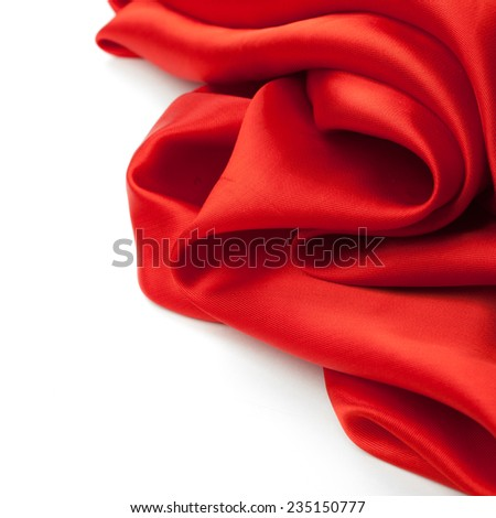 red fabric on a white background. studio shot