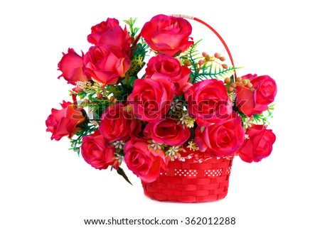 Red fabric roses in wicker basket isolated on white background. - stock photo
