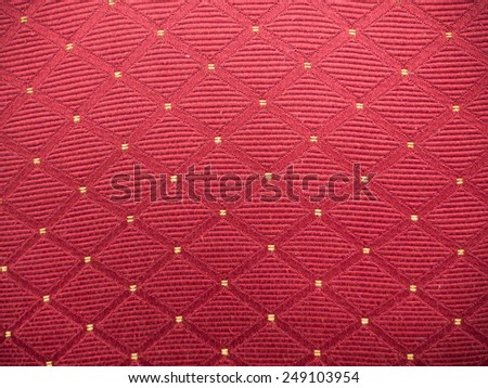 Red fabric with yellow tips texture - stock photo