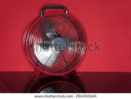 Red Famn on red background for summer cooling - stock photo
