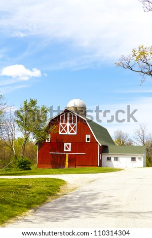 Red Farm With Cloudy Sky - stock photo