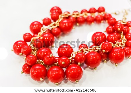 red fashion necklace for special event on white background - stock photo