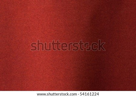 Red felt texture with slight curve   Focus is on flat area. - stock photo