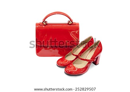 Red female bag&shoes on white background.