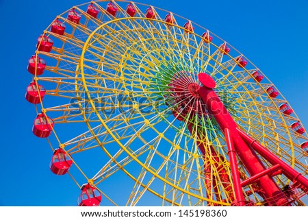 Red ferris wheel with blue sky - stock photo