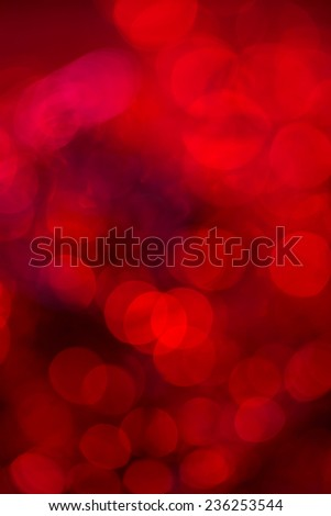 Red festive Christmas background. Abstract with bright twinkles, sparkles, blurred, defocused light. - stock photo