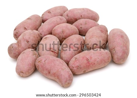 red fingerling potatoes close up on white background  - stock photo