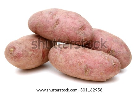 red fingerling potatoes isolated on white  - stock photo