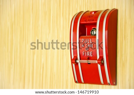 Red Fire alarm on the wooden wall with text area. - stock photo