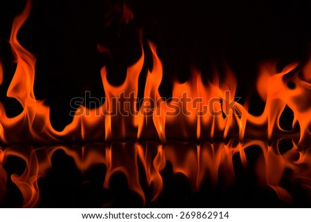 Red Fire flames on black background - stock photo