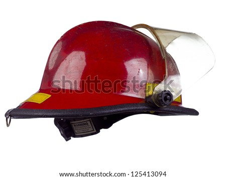 Red fire helmet over the white background - stock photo