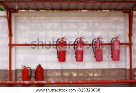 Red fire house in fuel tank station  blurred background