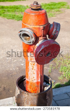 Red fire hydrant, close up vertical photo - stock photo