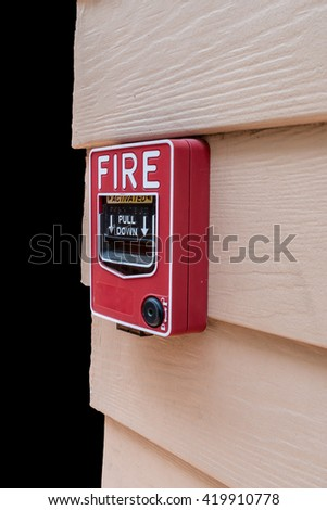 Red fire switch on wooden wall