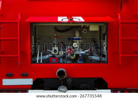 Red fire truck. Pumping equipment. Rear view. - stock photo
